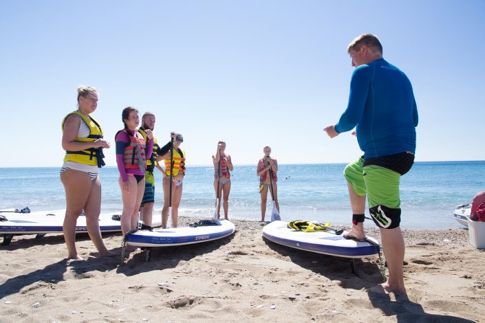 Group of Paddlers on a SUP Lesson listening to instructions
