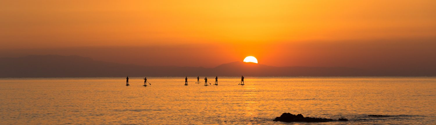 Stand up paddlers at Sunrise on Rhodes during Sunrise Paddle Tour