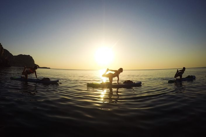 People doing Yoga on SUP boards at Sunrise as part of the Sunrise Paddle Tour on Rhodes
