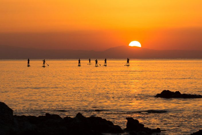 Stand up paddlers at Sunrise