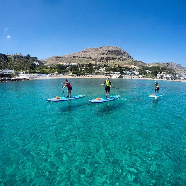 Stand up paddling in Stegna: crystal clear water, uncrowded and a stunning coastline.  #suprhodes #supadventure #sup #standuppaddle #stegnabeach #portoangelibeachresort #uncrowded #crystalclearwaters